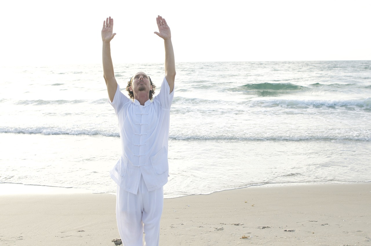 Middle Aged Man Doing Qigong on the Beach