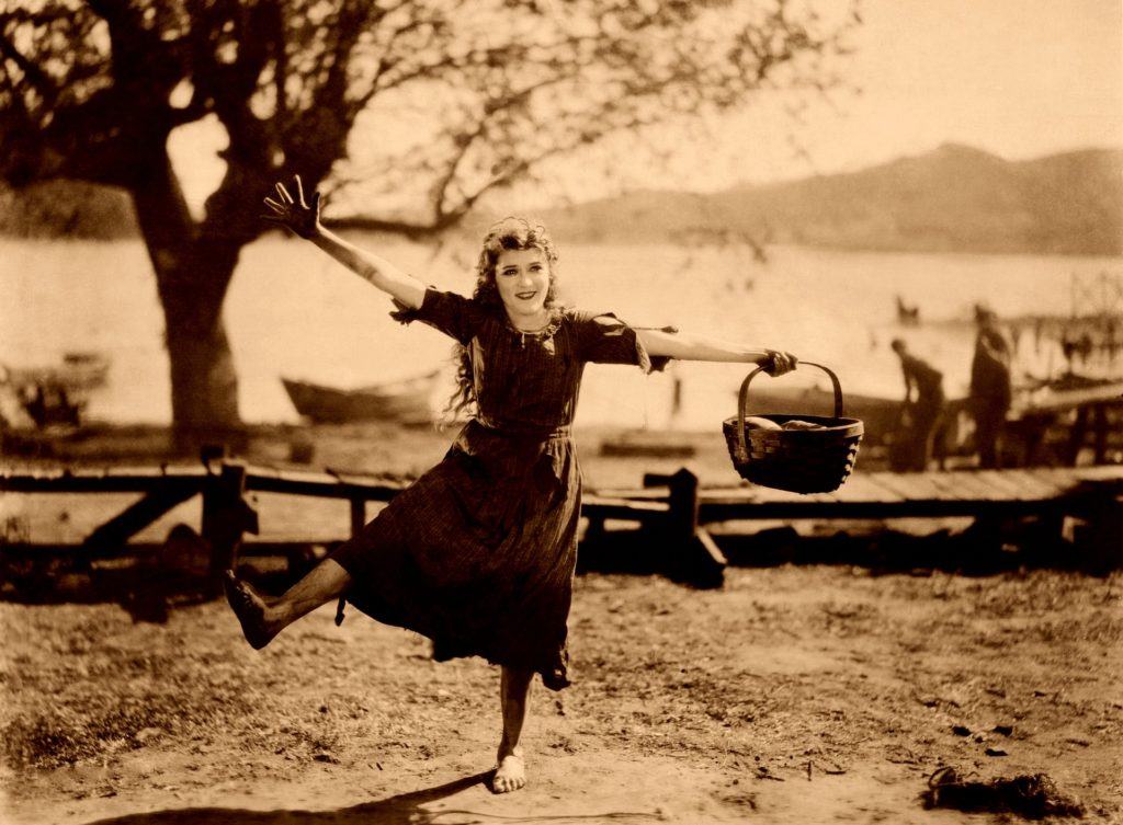 Dancing Woman with a Bucket