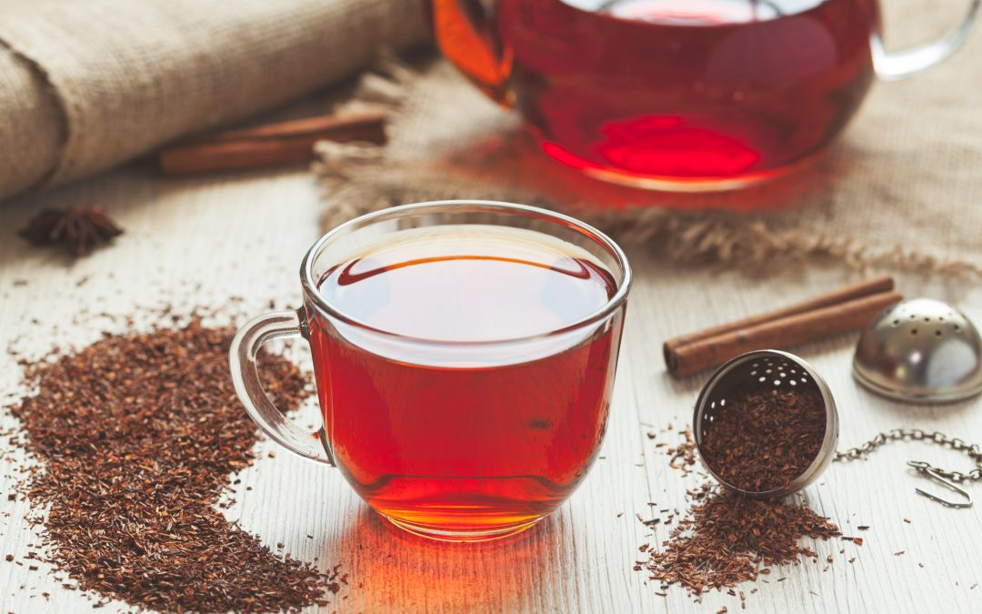 Healthy traditional organic rooibos tea with spices in rustic style