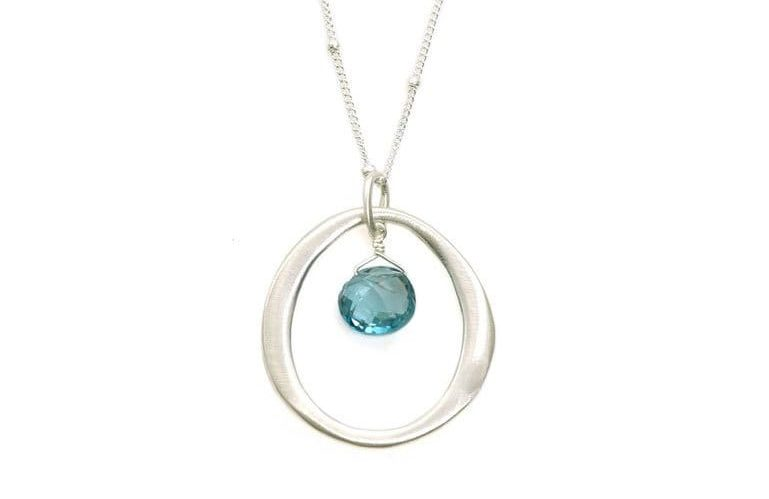 enso circle necklace with blue topaz in middle