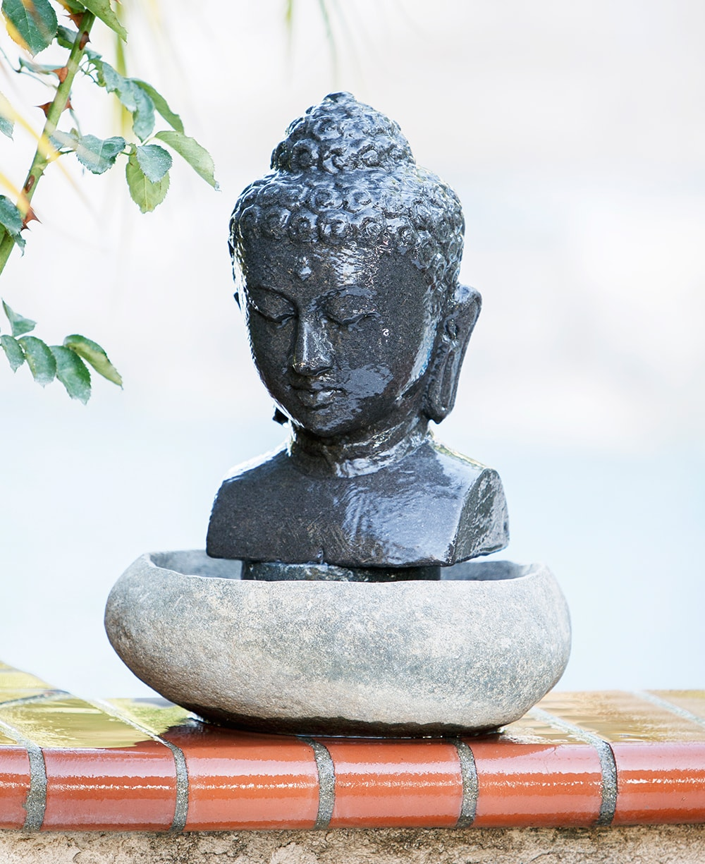 Buddha head fountain flowing waters