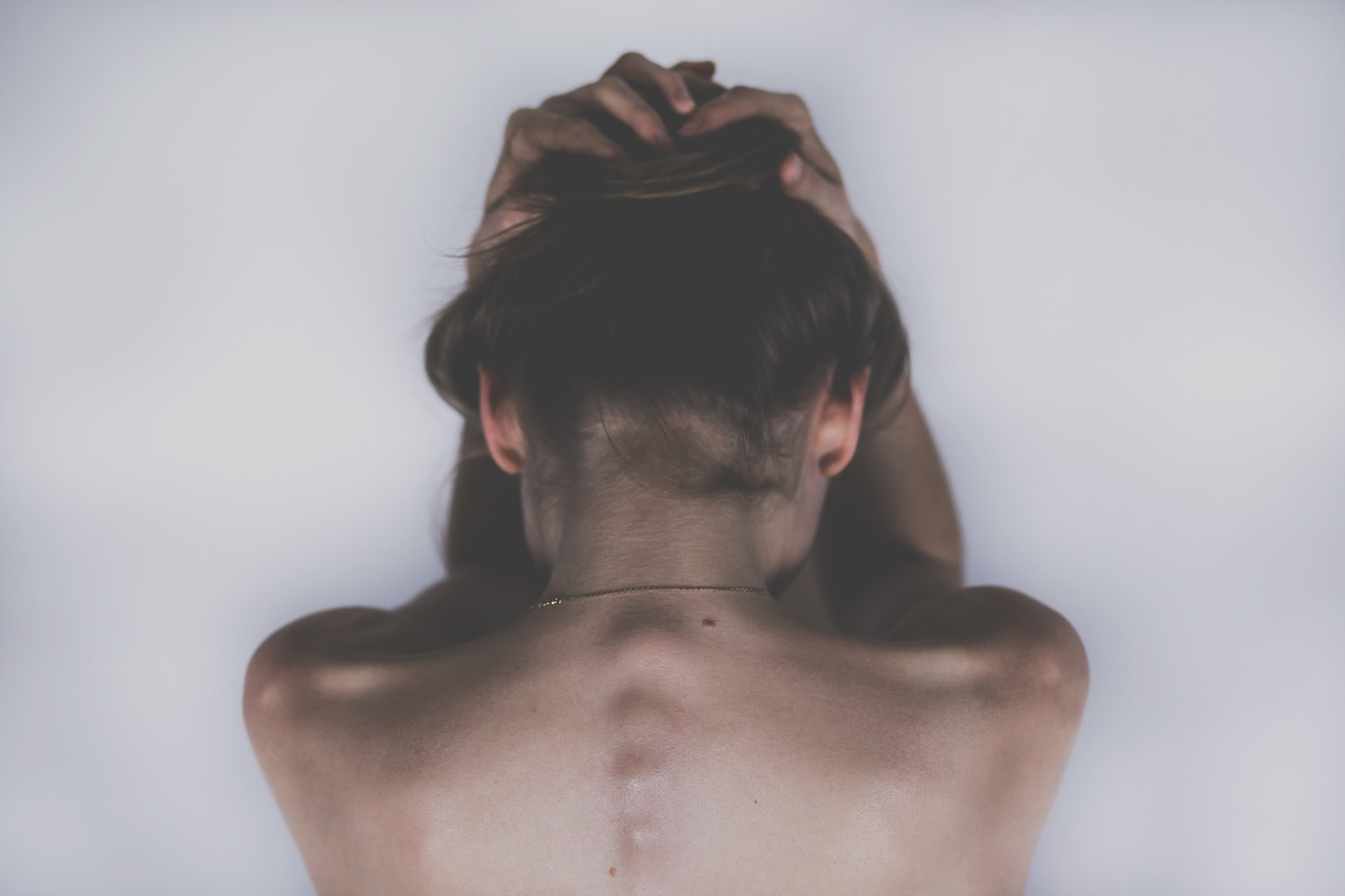 woman with tense shoulders and neck