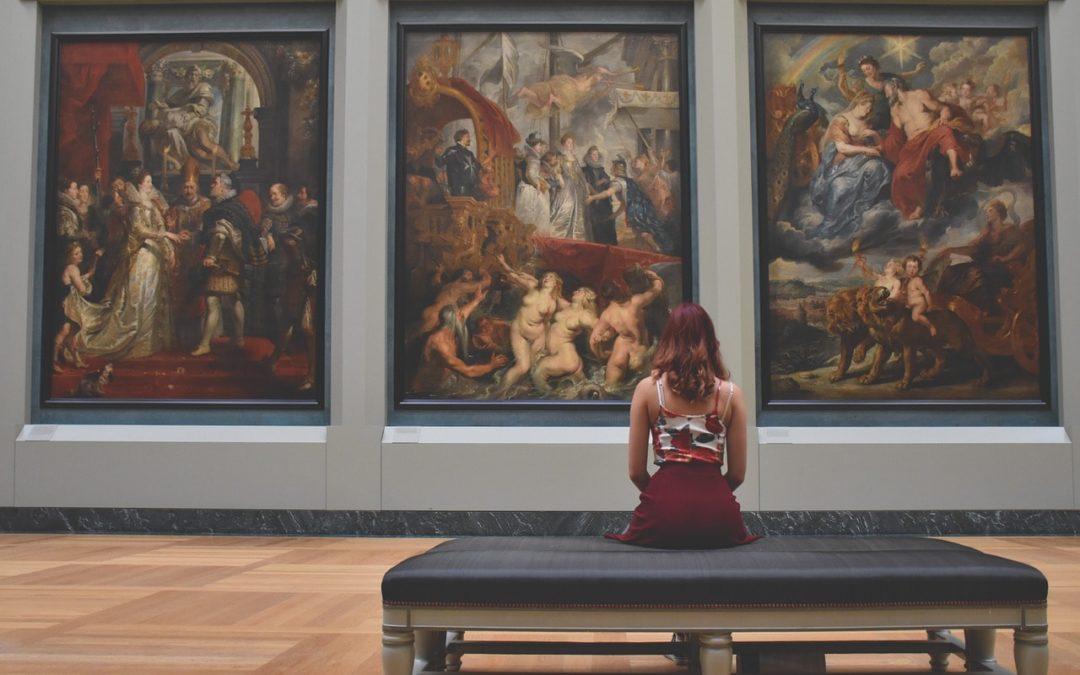 Woman sitting watching art