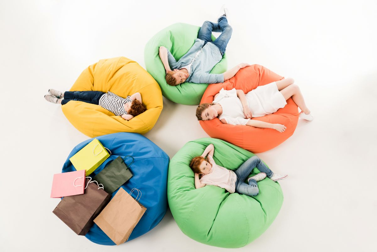 Family and kids sitting in bean bag chairs in a circle