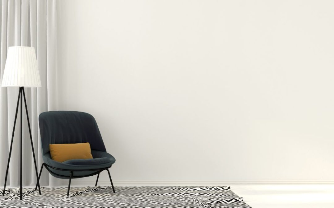 Floor lamp and a sofa in a white room
