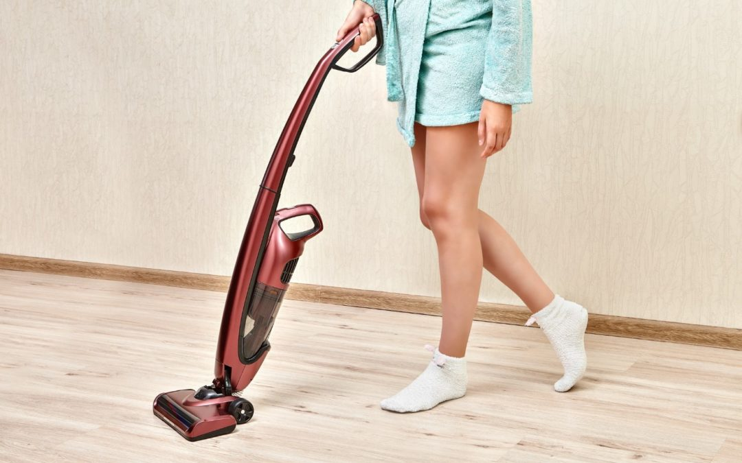 Woman with a cordless vacuum cleaner