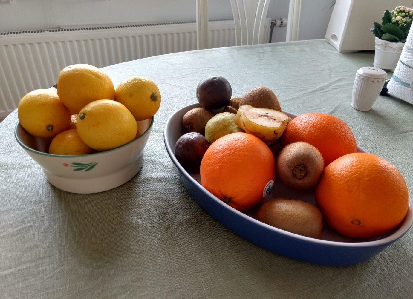 Fruits and lemons on table