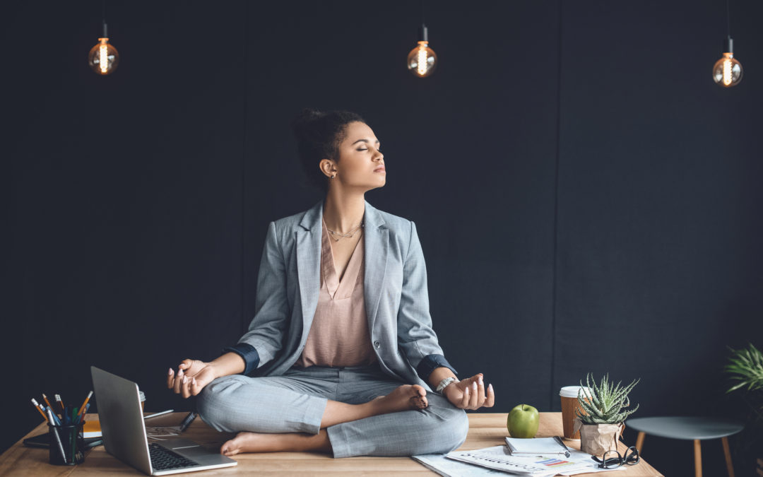 Woman meditating in a cozy office
