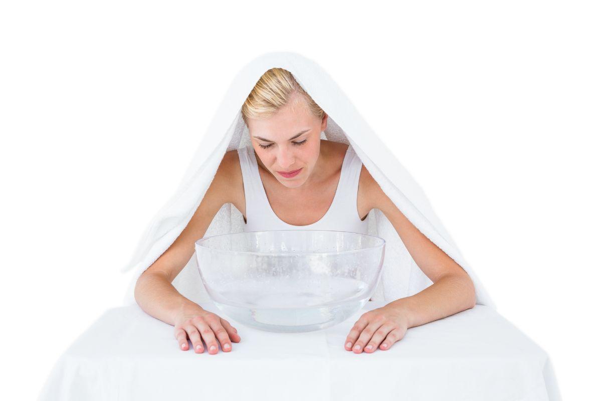 Blonde woman using steam inhalation