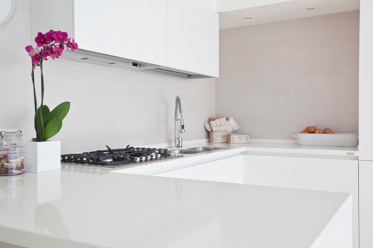 clean modern kitchen with a pink flower