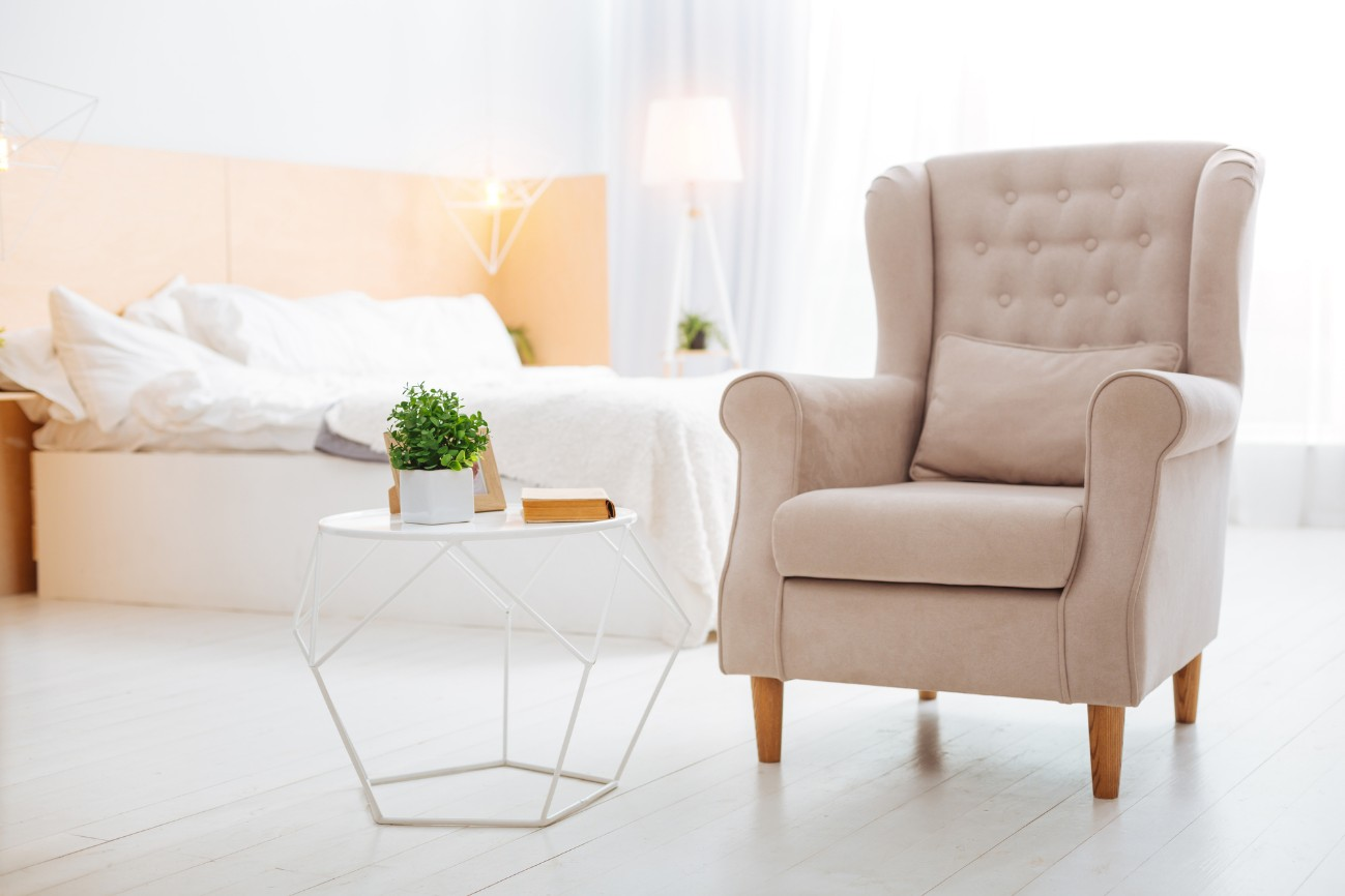Cozy bedroom with sofa and table