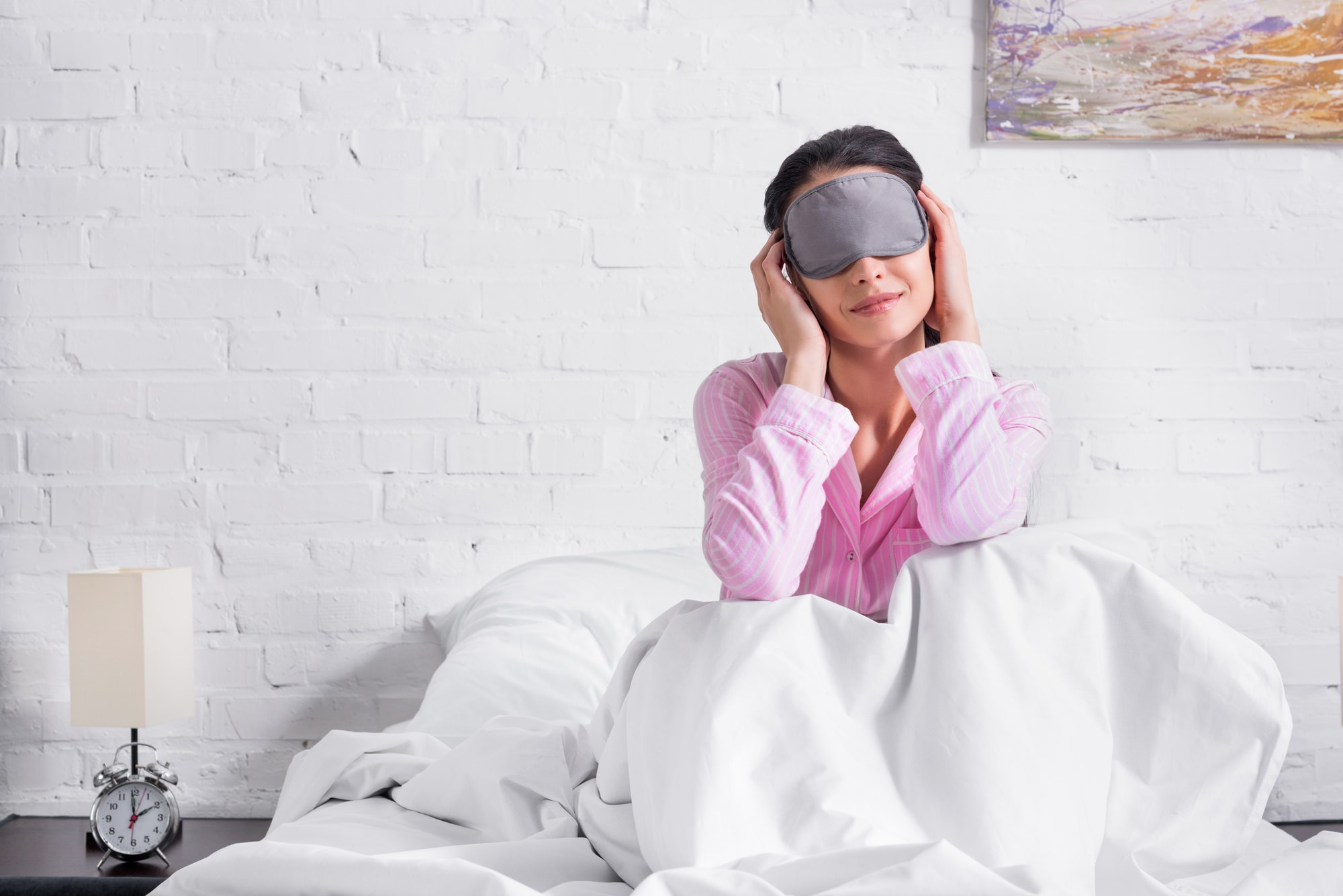 Woman smiling on the bed as she wakes up from sleep