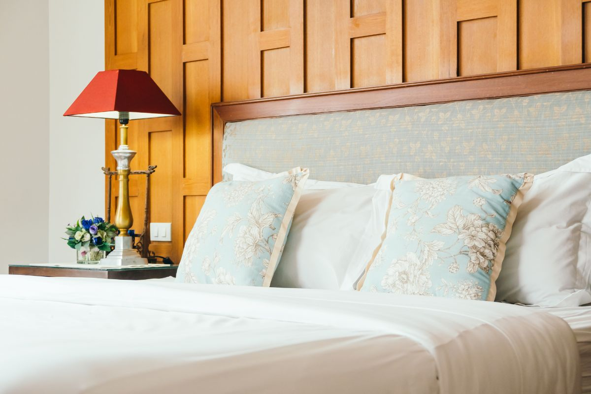 Cozy and inviting bedroom + pillows and bedroom lamp
