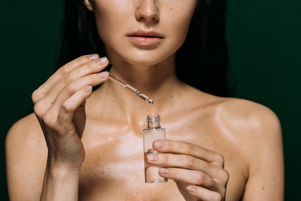 Woman holding a serum essential oil
