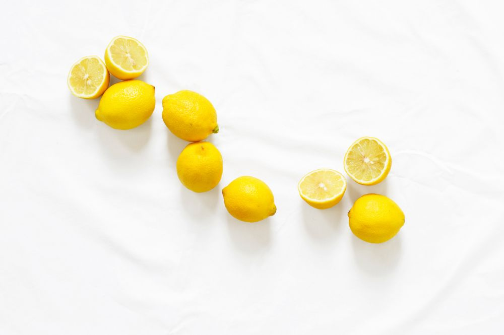 Sliced lemons on a white background