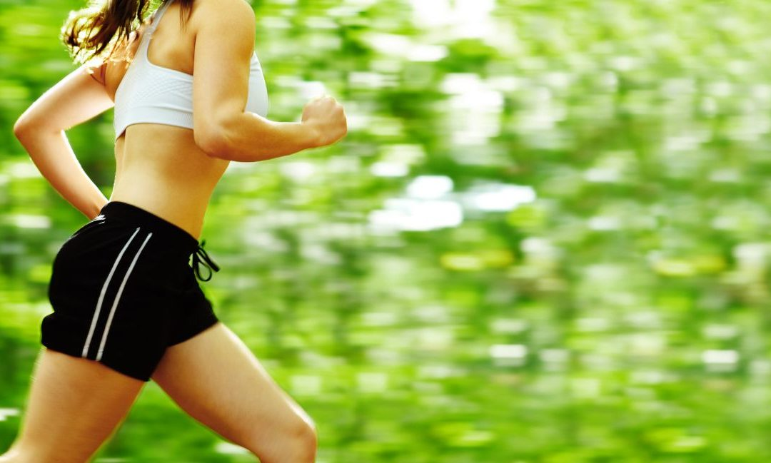 Fit woman running in the forest