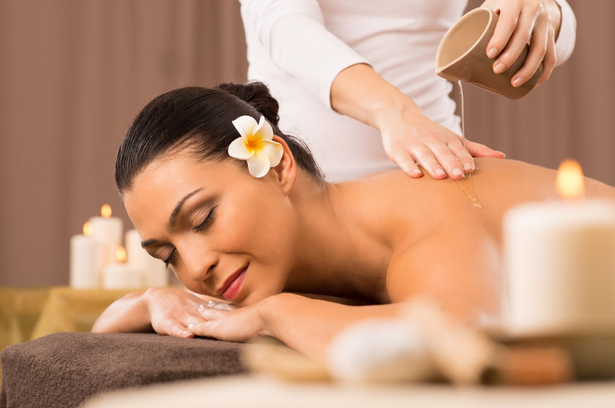 woman getting a massage with essential oils