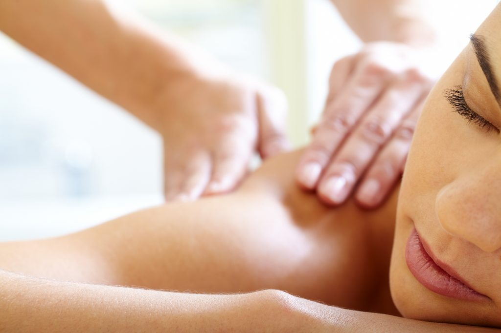 Part of face of calm female during luxurious procedure of massage