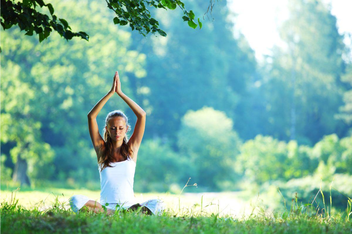 girl doing yoga outside in nature