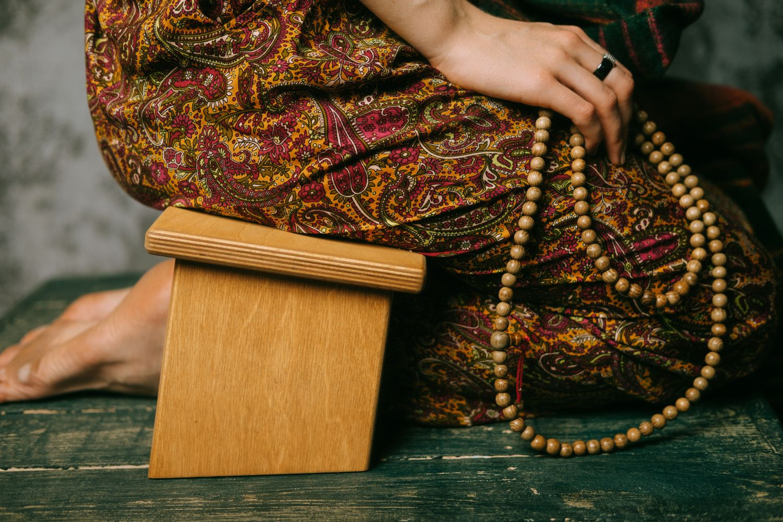 Meditation bench woman sitting with mala beads