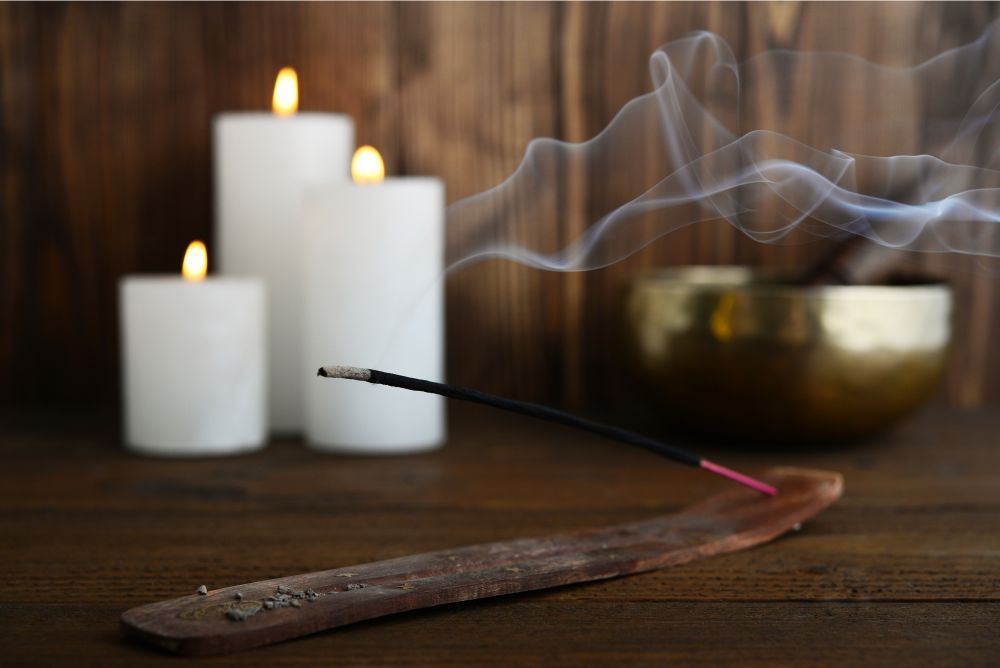 Incense, candles and singing bowl