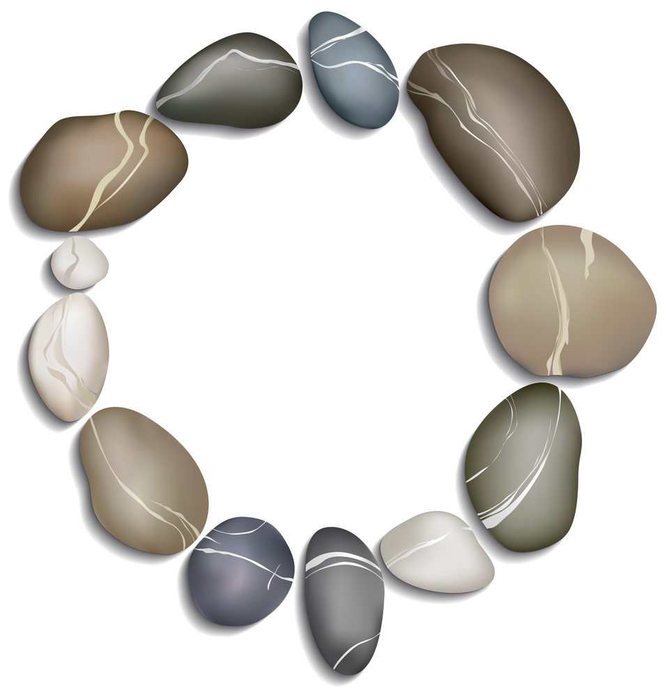 Circle of twelve pebbles on a white background