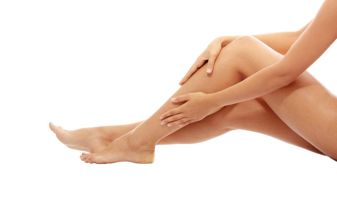 Woman stroking leg, self-massage