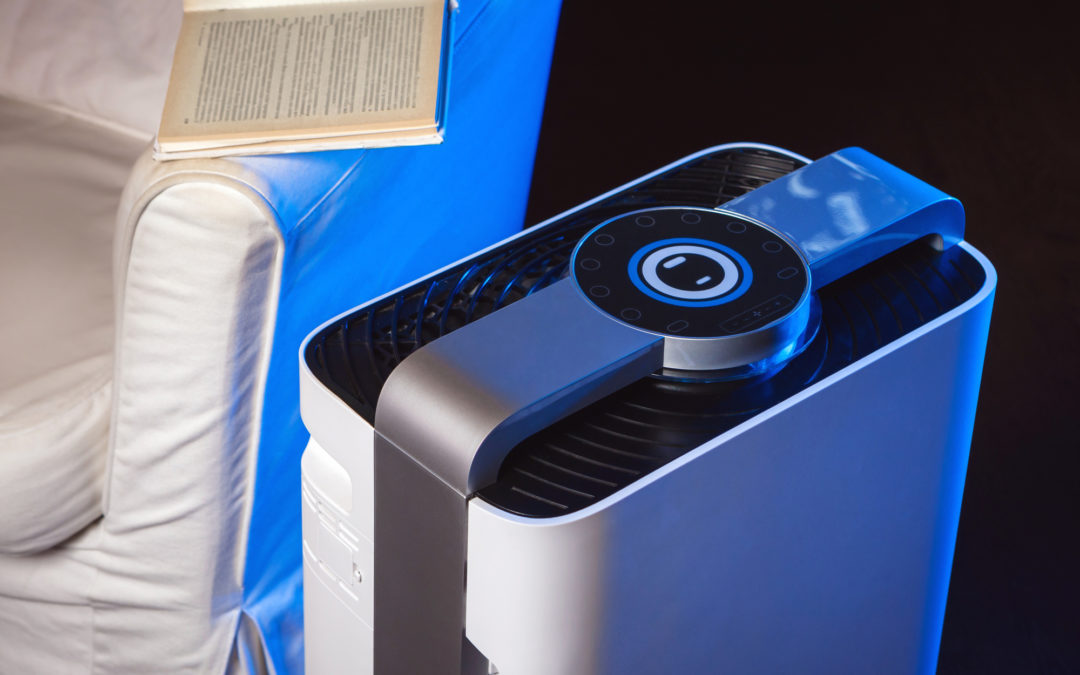 Stylish air washing device in the interior. Air filtration system. Air hygiene in the apartment. Cleaning dust and allergens. The microclimate of the house. Modern gadgets for home.