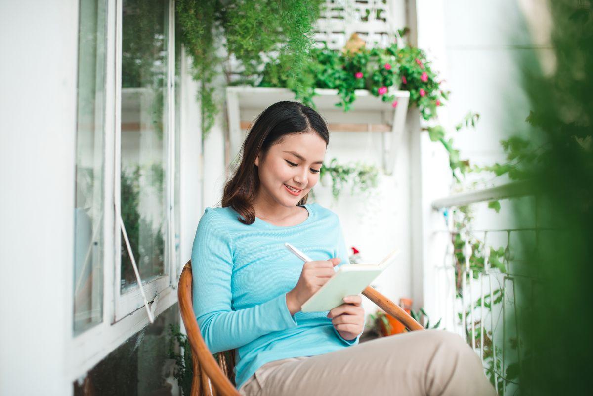 Woman writing in diary