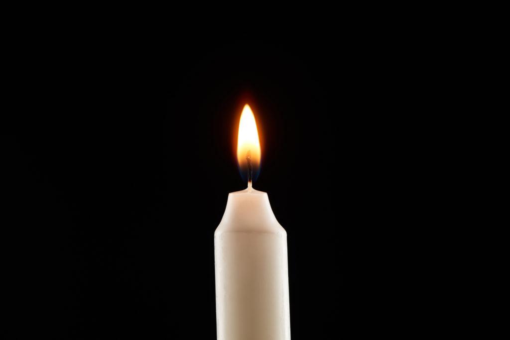 Candlelight on black bg