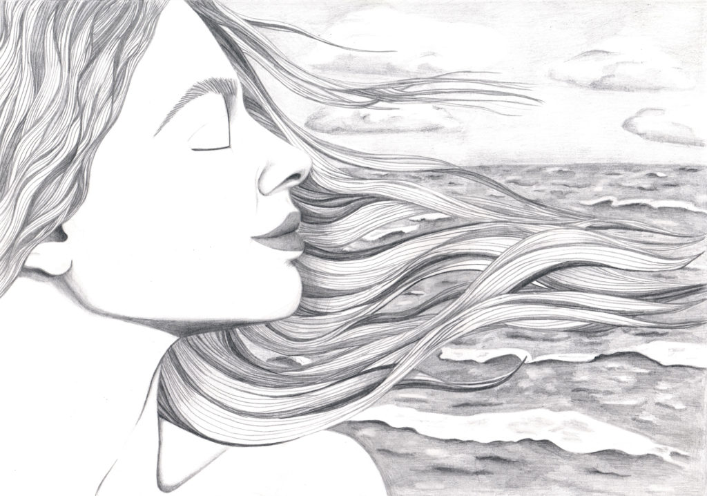 A woman's face with hair streaming in wind on a ocean's background
