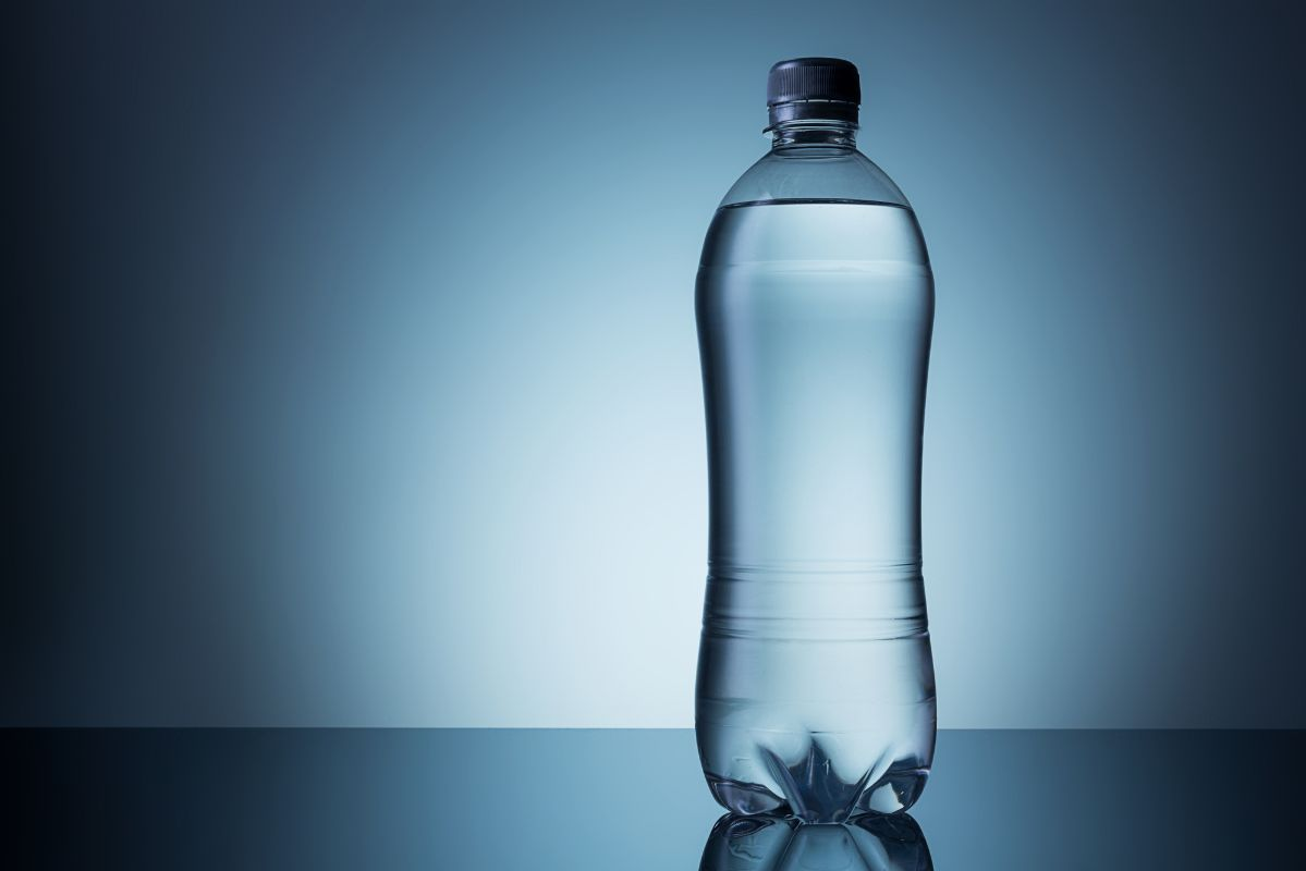 cold plastic water bottle blue background