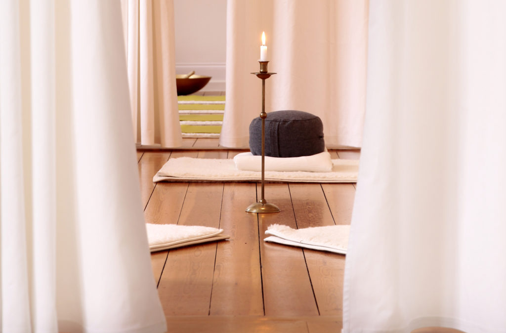 Meditation room with white curtains in a yoga studio