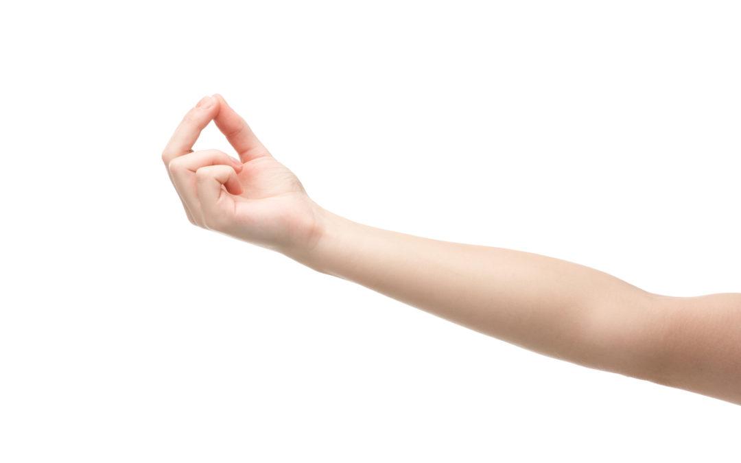 Woman hand fingers doing mudra white bg