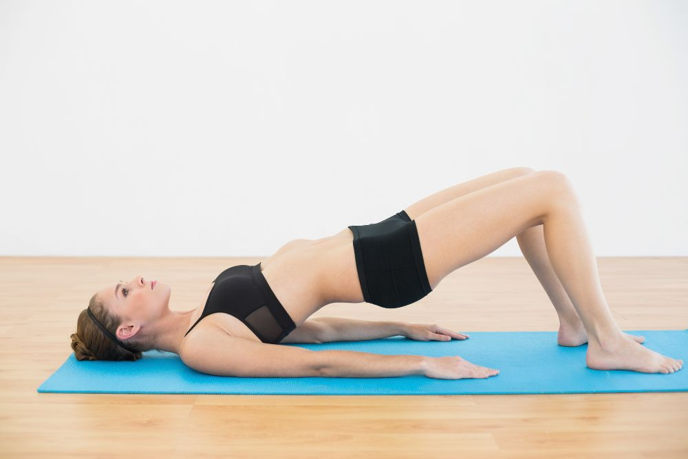 Pilates bridge exercise woman