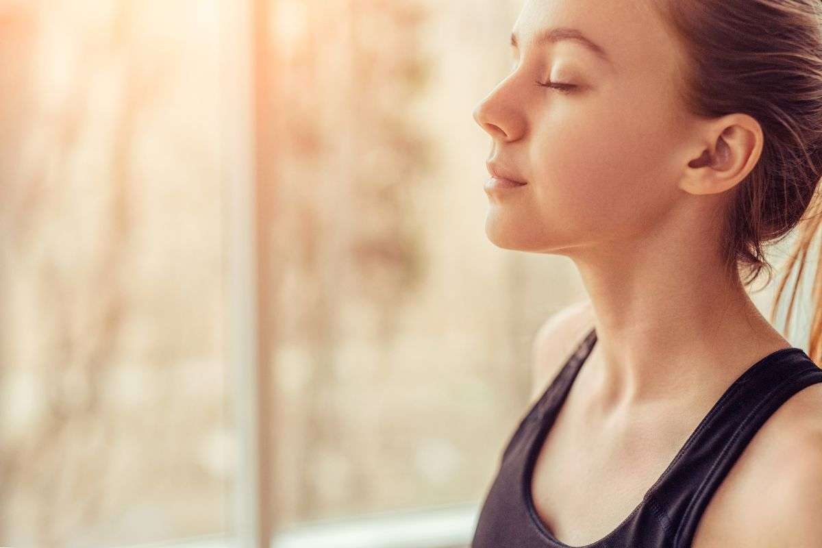 young woman doing deep breathing