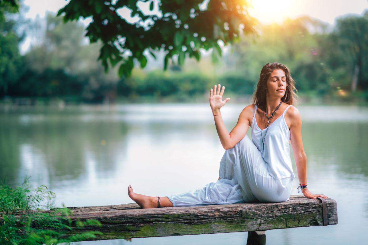 Woman doing yoga in nature seated twist pose