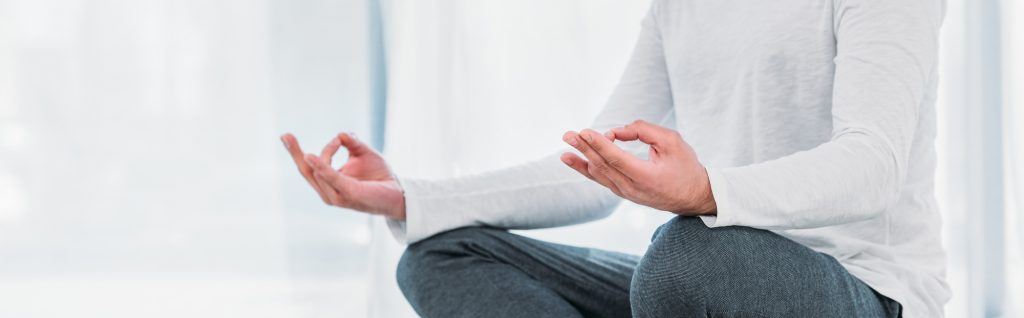 man sitting meditation mudra