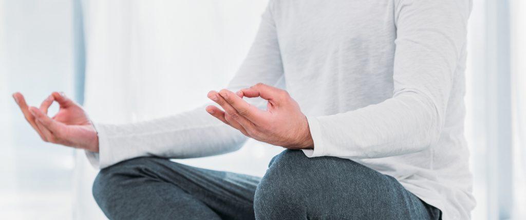 man sitting meditation mudra