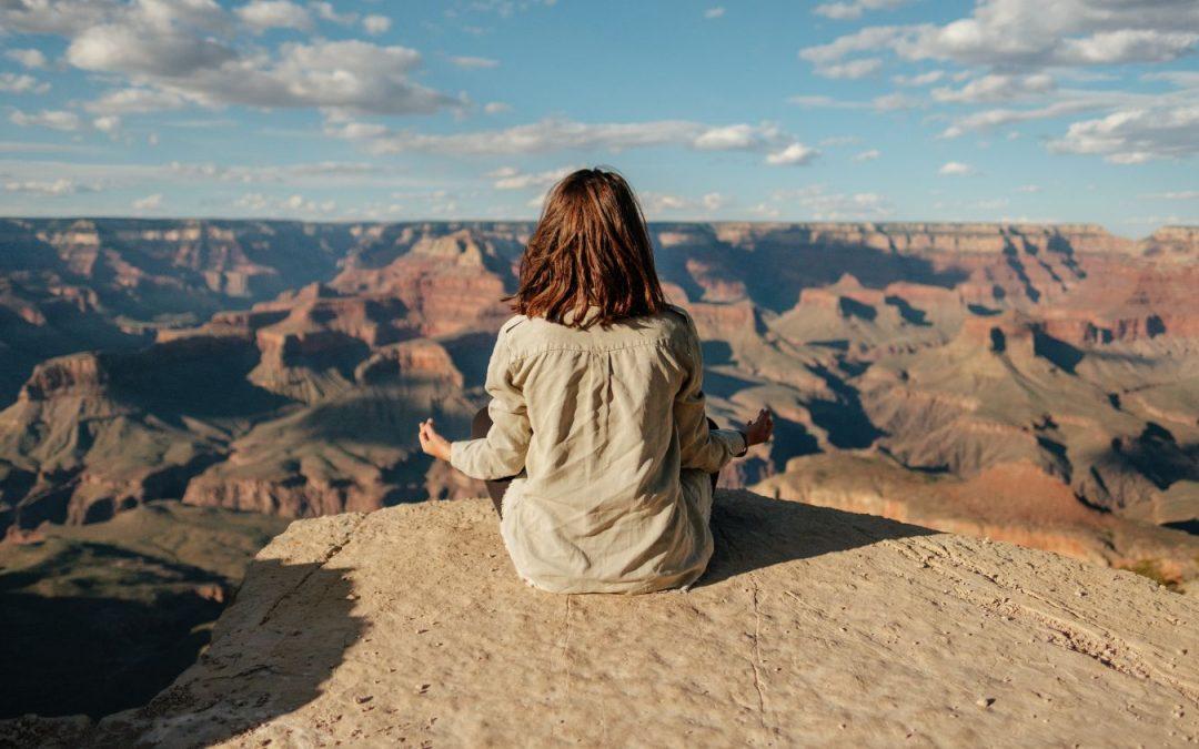 Woman meditation grand canyon