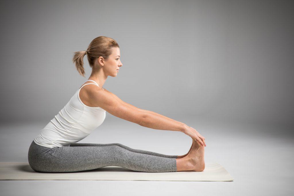 Woman pose yoga seated forward bend Paschimottanasana