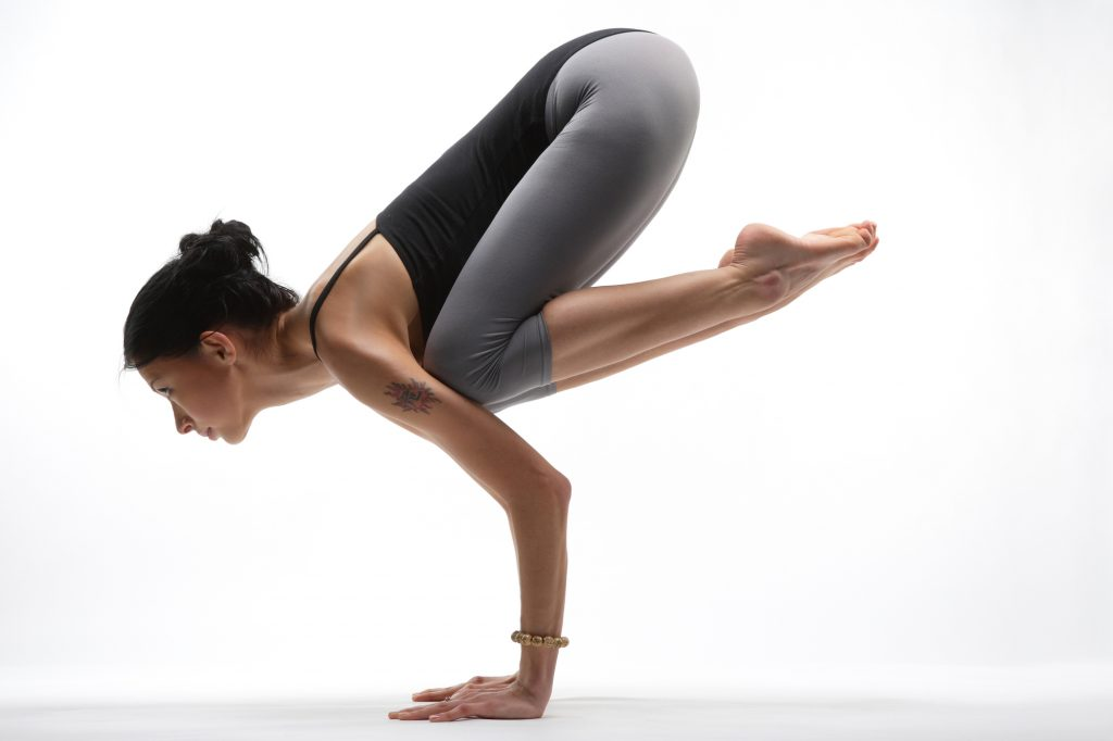 young yoga female doing pose / exericise