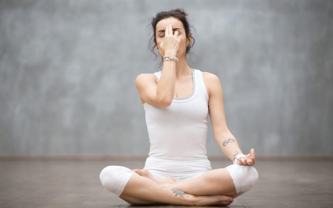 Yogic breathing technique woman